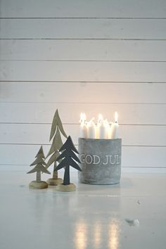 i couldn't love this more. trees, tins and candles