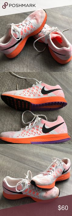 Nike Zoom Women's Pegasus 31 size 9.5 shoe Lightly used Nike's in white, peach/orange, and purple. Shoes are extremely comfortable, especially for walking around. My feet are extremely narrow, and I just can't use them for them gym or running because the fit is too loose. Will require your own in-soles. Nike Shoes Athletic Shoes