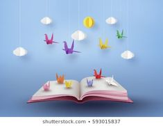 origami made colorful paper bird flying over open book and blue sky with cloud . paper art and digital craft style.
