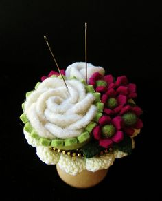 Pincushion made using sweater and hat felt, a piece of vintage doily as the base, and a bit of brass zipper.