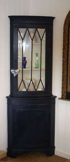 Lovely corner cabinet painted in Autentico Vintage Sailor Blue outside with Ivory inside.