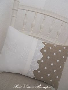 Old linen combined with contemporary polka dot fabric and a touch of antique lace. What a pretty cushion