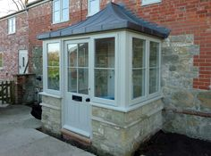 Porches Wiltshire Project Brief A welcoming entrance porch can add character to your home. Here is a selection of porches we have fitted to existing houses, new Porch Uk, Front Door Porch, Cottage Porch, Porch Doors, Front Porch Design, House With Porch, Front Entry, Front Doors, Porch Extension