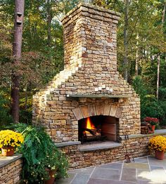 herringbone pavers with a large stone fireplace