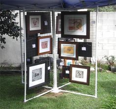Getting ready for our Garden Party Art Show on the Today I played with some black nylon netting. The pvc pipe/fencing display panel. Getting ready for our Garden Party Art Show on the Today I played with some black nylon Craft Fair Displays, Market Displays, Display Ideas, Booth Ideas, Craft Booths, Jewelry Displays, Art And Craft Shows, Craft Show Ideas, Art Display Panels