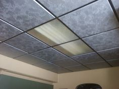 Painted Ugly drop ceiling with Hammered Silver Paint. Must remove tiles and Paint in well ventilated area