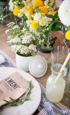 Pops of yellow in wedding decor are sure to brighten up any wedding. Love yellow!