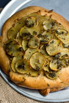NYT Cooking: This dough recipe makes enough for three focaccias, so bake one loaf tonight and freeze the remaining dough. This can be topped with sautéed ramps or  roasted potatoes, or simply brushed with good salt and olive oil. Baking it in a cake pan will allow for a nice-looking, gently domed loaf. (The New York Times)