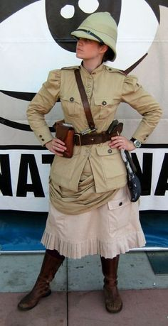 A Female Steampunk Explorer with a British Pith Helmet, Khaki Jacket, Leather Strappings and Boots. Steampunk Cosplay, Viktorianischer Steampunk, Steampunk Clothing, Steampunk Fashion, Steampunk Female, Steampunk Necklace, Gothic Fashion, Steampunk Theme, Steampunk Dress