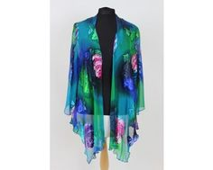 A beautiful waterfall style chiffon jacket in greens and blues. This is a perfect match to the dress that is also on our website www,middeltonwood. Wear with either the dress or maybe a plain coloured camisole and trousers for a diferent look. Jacket available in sizes 16-22