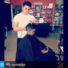 """#Repost @curtzkutz """"A little #curtzkutz action going on, cutting the owner of my schools son."""" The iCape is great for kids! Kids can stay entertained on their device while you style their hair, making cuts quicker and easier.  DM or Email us at info@capemakers.com to preorder your #iCape 2.0! Find us on FB at http://icape.biz  #barbershop #barber #hairstylist #salon #fade #shapeup #barbershopconnect #instabarber #barbercapes #thebarberpost #kidcuts #modernsalon #stylists #stylist…"""