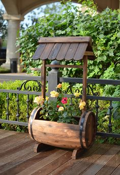 Antique wooden flower planter feature with large planting barrel and top roof, b. - Antique wooden flower planter feature with large planting barrel and top roof, balcony, patio, yard - Wood Barrel Planters, Wooden Planter Boxes, Log Planter, House Plants Decor, Plant Decor, Garden Yard Ideas, Garden Projects, Magic Garden, Wooden Flowers