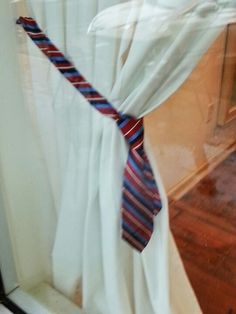 I saw this in a store window; using a necktie as a curtain tie back for a Father's Day display. Window Display Design, Store Window Displays, Store Front Windows, Tie Shop, Cool Curtains, Men Store, Curtain Tie Backs, Craft Fairs, Fathers Day