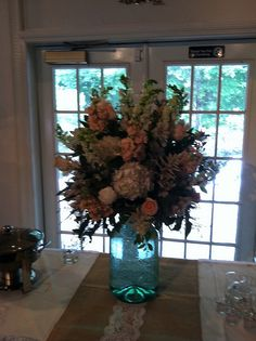 Buffet Table centerpiece - white snapdragons, peach stock hydrangeas, peach roses, blue thistle, astilbe, alstroemeria and seeded eucalyptus. | Flickr - Photo Sharing!