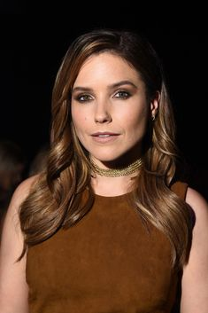 "This Is Proof That Sophia Bush's Hair Has Been Perfect For A Decade #refinery29 http://www.refinery29.com/2016/12/132532/sophia-bush-birchbox-beauty-evolution-photos#slide-14 At the Cushnie Et Ochs spring '16 show in NYC this past September, ten years from when we started, the actress matched her smoky taupe eyes to her suede dress for a warm, chocolate-y look. Her shiny brunette waves helped, too — we get why fans call her ""Detective Hair Porn,"" that's for sure...."