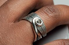Silver Metal Clay Adjustable Ring with Textured Sage Leaf Pattern and a Swirled Stem. $70.00, via Etsy.