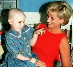 July 21, 1997: Diana, Princess of Wales with patient, Hollie Robinson-Marsh during a visit to the Northwick Park Hospital in Harrow, London, where she unveiled a foundation stone for the children's casualty department.