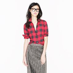 Plaid button-up shirt from J. Crew. Plaid and checkered button-ups have re-emerged as staple wardrobe pieces for women, and are not only being used for casual wear, but also being dressed up with skirts and more formal attire. This suggests a trend in appropriateness and of mixing traditional menswear items into women's attire.  Christina S.