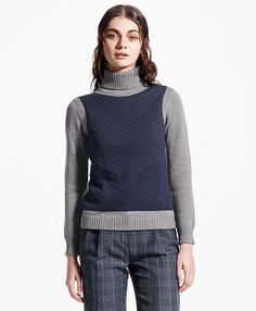Turtleneck sweater. It's like a vest and a sweater in one! Super stylish.