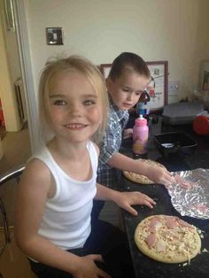 Kids making pizza for their dinner-too cute