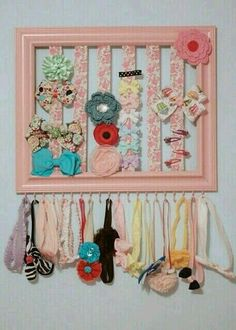 Picture frame with pieces of ribbon & tiny screw hooks at bottom (can hold child's headbands or jewelry) makes the cutest bow & hair accessories holder.  G:)