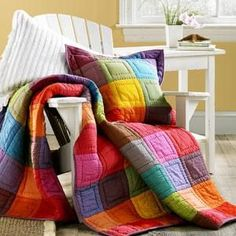 solids quilt- love the colors - love the simple quilting.