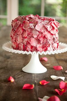 Red velvet cake covered with rose pedals
