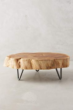 Footed Wood Slab Tray - anthropologie.com. | Would love to put my tall snake plant on something like this.