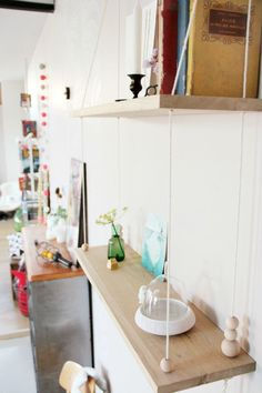 Tête D'ange used oak wood to make this Scandinavian inspired swing shelf, but you could easily use reclaimed wood.