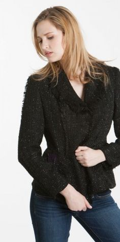 Cozy up in this knit jacket, available in black and purple