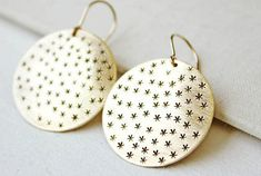 These sweet earrings feature a bevy of hand-stamped stars.