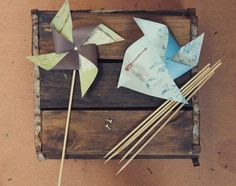 Make your own paper windmill! I think this'd be great using laminated maps
