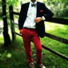 Red pants, navy blazer, and a bowtie.  A true look for a true gentleman.  Classy.