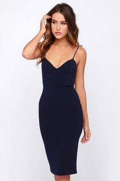 LuLu*s Exclusive! From sunup to sundown, the Midi of the Night Navy Blue Bodycon Midi Dress will keep your bodycon look on point! Skinny spaghetti straps support a shapely triangle bodice with darted detailing and plunging V-neckline. The bodycon skirt steals the show as it hugs your curves down to a flattering midi-length hem with kick pleat at back. Hidden back zipper. Front of bodice is lined. 66% Rayon, 30% Nylon, 4% Spandex. Hand Wash Cold. Made With Love in the U.S.A.