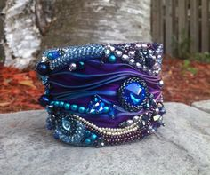 OOAK Bead Embroidered Cuff-Etsy Bead Embroidery Guild Beadfest- Swarovski Rivolies-shades of blue and purple, shibori ribbon