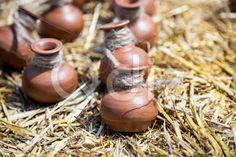 Qdiz Stock Photos | Small ceramic crocks or pot on straw,  #antique #brown #ceramic #chatty #clay #countryside #crock #decoration #empty #object #pot #round #small #souvenir #straw #traditional