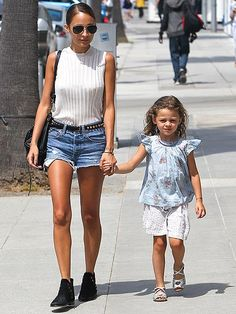 Hollywood's Most Stylish Moms: Only Nicole Richie could pull off a vintage-y white top, denim cutoffs and black booties for a mommy-and-me stroll.