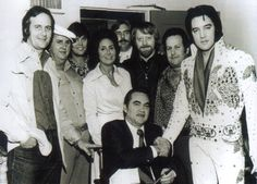 Elvis in Montgomery march 6th 1974 before a concert. Red West is in the middle in the picture. Elvis shaking hand of Governor Georges Wallace. Elvis was wearing his Aloha eagle suit.