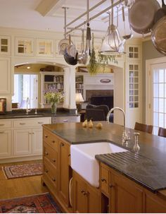 Much to love, but especially the sink, built-in dish drainer counter top and cabinetry above the passageway