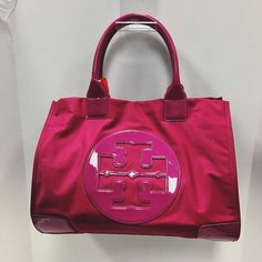 Tory Tote  Fuschia nylon w/ patent handed and corners PLDTW Price:$124.99 Item #:10700-90  Location: Buckhead To purchase or see more pictures and details call 770.390.0010 ex. 1  #alexissuitcase #buckhead #atl #atlantaconsignment #thriftatl #resale #highenddesigner #consignment #luxury #designer #resaleatlanta #boutique #atlanta #fashioninspiration #shopmycloset #upscaleresale #toryburch #toryburchbag by alexissuitcase