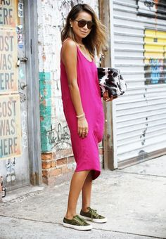 Jules Sariñana of Sincerely Jules wears a pink tank dress, olive green sneakers, and a snakeskin clutch
