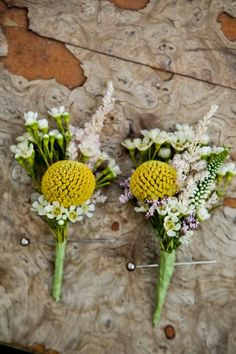 Boutonnieres featuring yellow craspedia, waxflower, astilbe, veronica, and limonium.