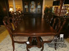 Formal dining room table with 10 chairs! These are hard to find consigned. Just in time for your holiday dinners.  Measures 68 x 43 x 30. Arrived: Monday November 7th, 2016