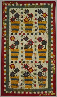 Asters- Layer Cake quilt pattern by Dawn Heese at Linen Closet Quilts.  Folk art design, Fall 2014 debut.