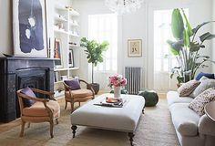 Elegant living room -- love the ottoman as a table idea