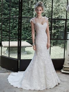 Maggie Sottero - MARIGOLD, Elegant and unadorned, this classic lace A-line wedding dress exudes timeless romance, accented with a feminine sweetheart neckline. Finished with corset closure or covered buttons over zipper and inner elastic closure. Detachable lace cap-sleeves are offered separately.