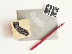 Personalized return address stamp in the shape of your state.  Love it!