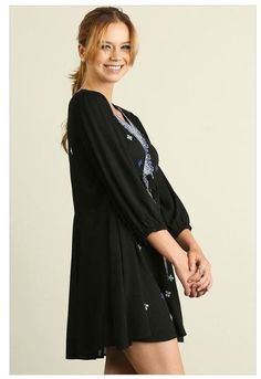 OurDream In Black Embroidered Long Sleeve Swing Dresswill leave you feeling dreamy.Lightweight woven fabric, in burgundy with creamandblue embroidery which falls from a darted cutout neckline, into long three quarter sleeves with elasticized cuffs. Flirty sheath skirt with tying, drawstring waist. Cream and blue embroidered crochet sweeps down the neckline to the bodice to the hemline. #casualdress  www.ledyzfashions.com #falldresses