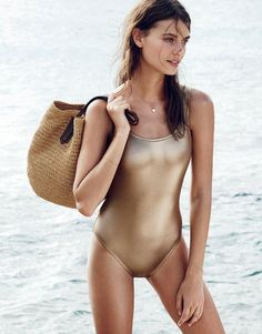 J.Crew women's metallic gold scoopback one-piece swimsuit and market tote. To preorder call 800 261 7422 or email verypersonalstylist@jcrew.com.