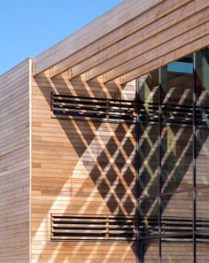07 - Genius use of a wooden pergola and light to create graphic patterns on the facade. From Foster and partners for the West London Academy, close to our office in Ealing!